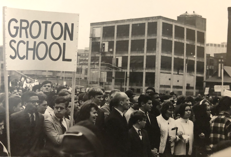 Groton students marching, holding a