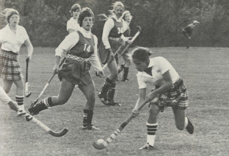 Groton girls playing field hockey