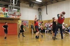 XD teacher Patrick takes a shot at the basket against CFS eighth-graders.