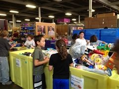Students volunteer at Cradles to Crayons