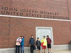 Students pose in front of Moakley Courthouse.