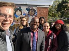 Harvard Graduate School of Education students pose for a selfie with Head of MS and Director of Diversity, Equity, and Inclusion Jack Hill.