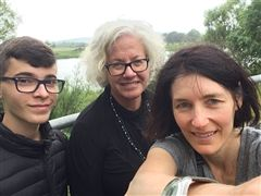 Polly (right), Taliah, from Israel (center), and her student Ben (left), standing on a bridge over the Shannon River on the campus of the University of Limerick while at the Narrative 4 conference in Ireland.