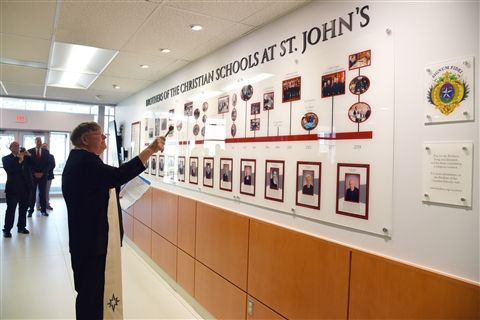 Msgr. John Enzler '65 returned to campus to bless the new Brothers' Heritage Wall.