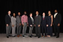 From left: Brian Keller '64, Shawntese Charles '99, LJ Hoes '08, Orlando Wright (accepting on behalf of Chris Wright '07), Jim Burns '81, Thomas Graham '78, Keegan Teare '95 (accepting on behalf of John Haley '57), Kristen Dozier '06 And Conrad Bolston '03