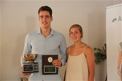 Katie Ross'13 awarding Connor Keefe'17 his Male Athlete of the Year trophy