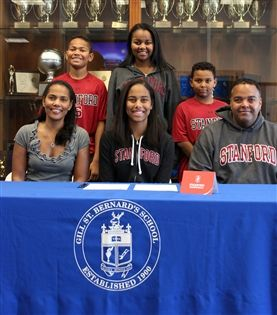 Taylor Rooks '14 is joined by her family while signing an official National Letter of Intent with Stanford University.