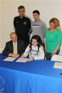 Jasmine Sina '14 signs an official National Letter of Intent to play Division I basketball at Binghamton University in the fall. She is joined by GSB Headmaster Sid Rowell, her parents, Mergin and Jill Sina, and her brother Jaren Sina '13 during the signing in the Athletic Center.
