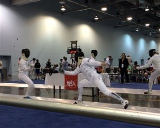 Luke Fischer '16 (r.) competes in the Division III men's epee competition at the National Fencing Championships on June 22.