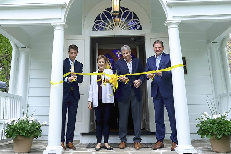 Head of School Mark Anderson, philanthropists Nancy and Mike Pia, and Board of Trustees President Ted Dwyer cut the ribbon at the entrance of the newly renovated Kenneth D. Jones Memorial Chapel.