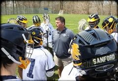 Sanford Coach Tim Lucky (center) has been named Delaware's Boys' Lacrosse Coach of the Year. Photo courtesy of Ted Rosenthal/Izmaddy Studios.