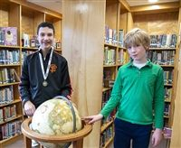Evan Michaeli, left, winner of the Geography Bee, and Nate Felix, winner of the Spelling Bee