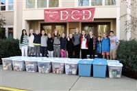 Middle school students, who spearheaded the annual Thanksgiving food drive, collected 21