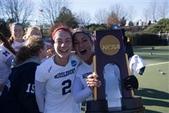 Anna Kenyon, left, celebrates Middlebury's NCAA win