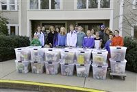 Dedham Country Day middle school students, who spearheaded the school's annual Thanksgiving food drive, collected 24