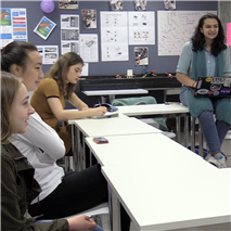 "Girls Who Code club members discuss their upcoming ""hackathon,"" scheduled for April 15."