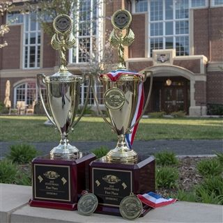 NCS's two D.C. championship trophies. The Eagles also won 10 gold medals Saturday for event victories.