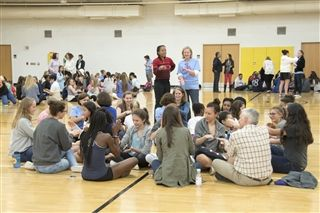 Head of School Kathleen O'Neill Jamieson joins with Director of Community Service Nadirah Moreland in a school-wide cooperative activity as part of Diversity Forum 2017.