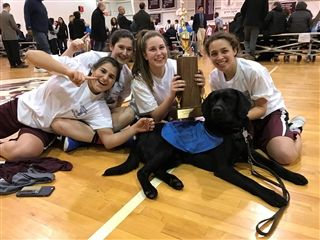Girls basketball champs with the athletic trainer's dog Bunker
