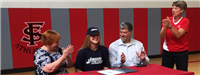 Sydney Wilson '18 with her parents, Jenness Hall and Peter Wilson, and coach Judy Turnbaugh.