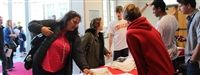 Senior Russian students register guests during the April 2 Maryland ACTR Olympiada