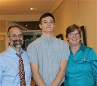 Kyle Spawn '17 with his proud parents, Middle School science teacher Andy Spawn and Carla van Berkum