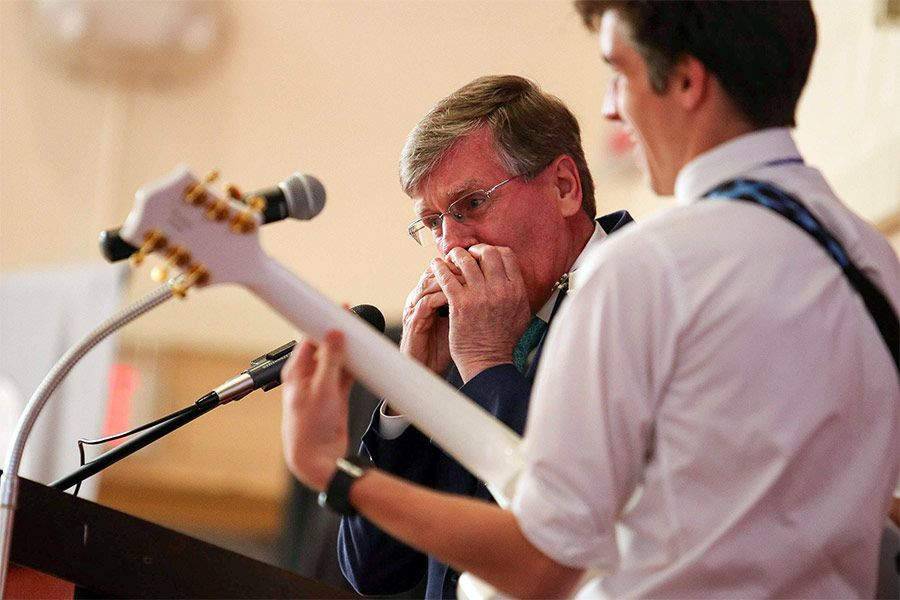 Mr. Thomas Beatty plays the harmonica at his his June 2019 retirement ceremony at Catholic Memorial.