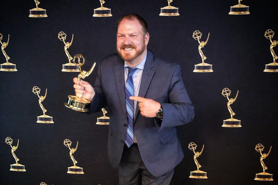Mr. Hawkins poses with his Emmy trophy.