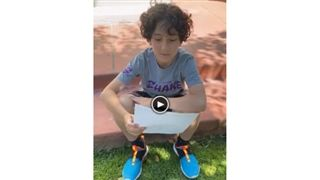 Boy Reads Blue Shoes