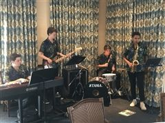 US musicians perform for the Benedict Legacy Society members.