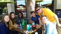 Lucy, Sophia, Kenzie, Ivor, Mr. Baker and Gaylen take a break from competition to enjoy lunch in the sunshine.