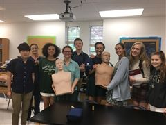 A&P students strike a post with CPR training mannequins