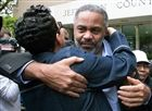 In this April 3, 2015 photo, Pat Turner, left, hugs Anthony Ray Hinton as he leaves the Jefferson County jail in Birmingham, Ala. Hinton spent nearly 30 years on Alabama's death row.  Hinton was freed after new ballistics tests contradicted the sole evidence used to convict him of two Birmingham murders. (AP Photo/Hal Yeager, File)