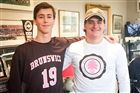 Soccer player Nick DeSalvo (#19) wearing the new game jersey and football player Lachlan Rosato modeling the T-shirt.