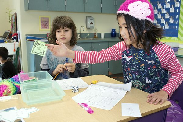 Third graders learn how to handle money in preparation for the Secret Shop opening next week.