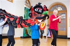 Pre-Primary students perform the dragon dance in the dance studio with Elly.