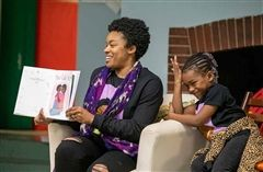 Author Heather Burris and her daughter Autumn take turns reading Hair Like Me to Pre-Primary students.