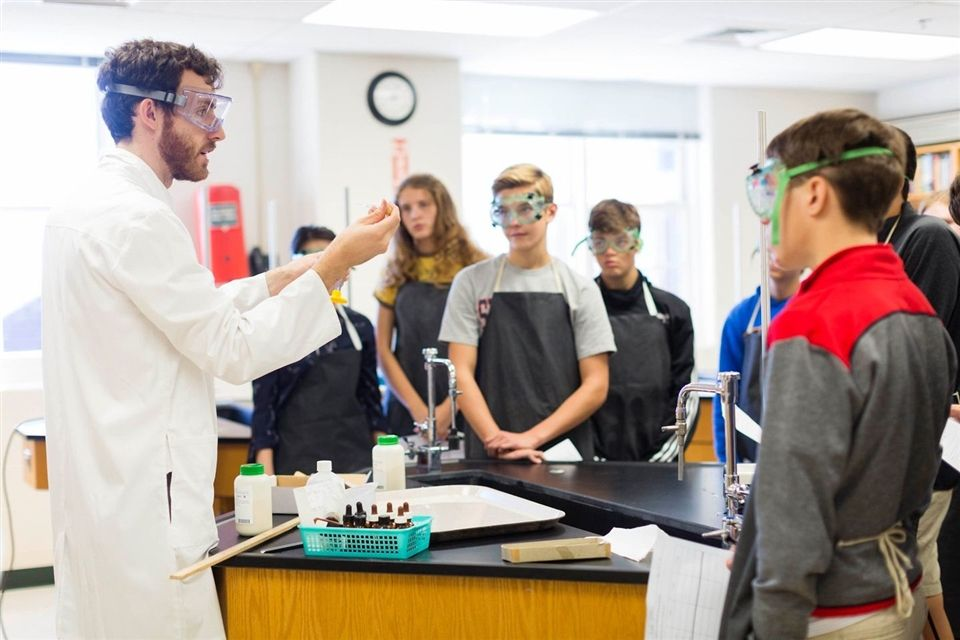 Science teacher demonstrates a chemistry lab.
