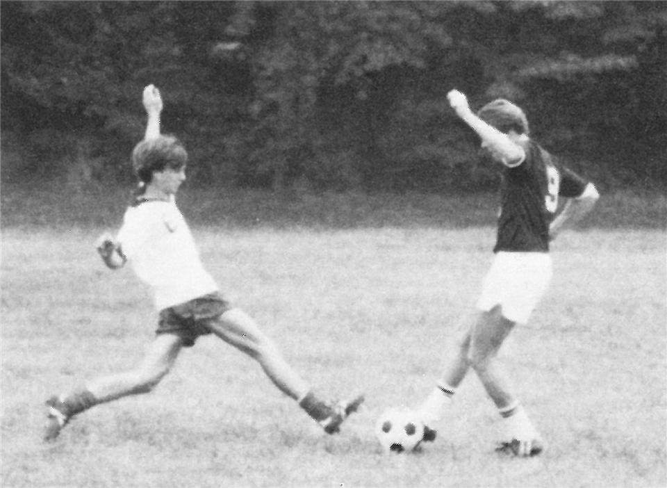 1982 Co-Ed soccer players on field - St. Andrew's Episcopal School