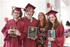 Latin teacher Kristin Webster with some of her high-achieving students at the 2019 Senior Awards Assembly
