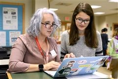 Dr. Amanda Waugh works with an Upper School student in the Dreyfuss Library at St. Andrew's Episcopal School