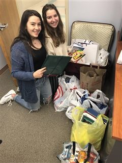 Junior Noa Russo and Senior Michelle Bilmes pack donations to bring to the Office of the San Juan's Mayor Office next week.