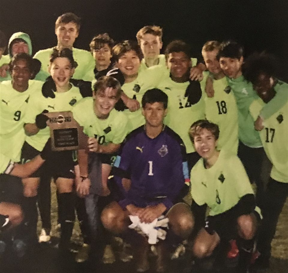 Senior Grant Harkins (bottom right) was a co-captain of the 2019-2020 district championship soccer team.