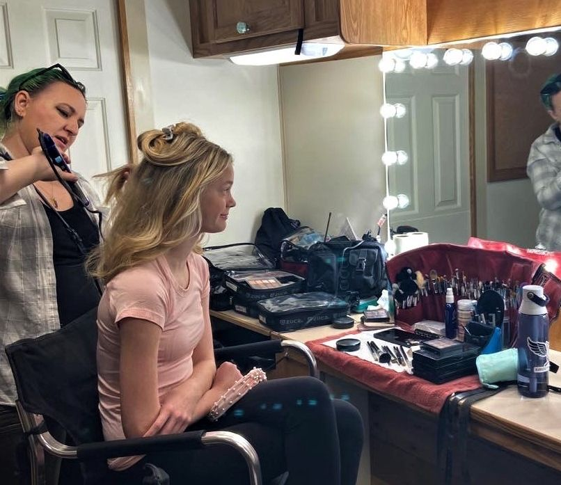 Alexa sits for makeup and styling session for a shoot in pre-COVID times.