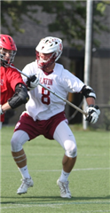Senior Will Weitzel defends against an opposing attackmen