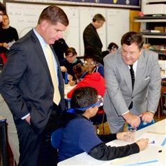 Boston Mayor Marty Walsh and Headmaster Brennan visit an 8th grade classroom at Perry K-8 School in South Boston.