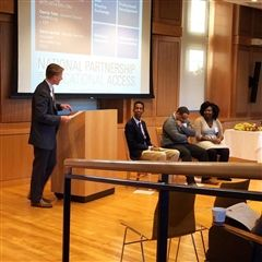 Andy Chappell moderated the seminar's panel, which included Mahamud Hashi Class II (second to Andy from the left).