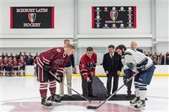 Martin J. Walsh, Mayor of the City of Boston, and Headmaster Brennan lead the ceremonial puck drop at center ice of the new IAF