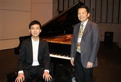 Chris with Professor Manabu Takasawa, the competition director and faculty in piano of the University of Rhode Island.