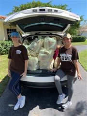 Seniors Rebekah Raffalski, Camila Perea, and Tyler Hannon (not pictured) collected donations for Feed Miami.
